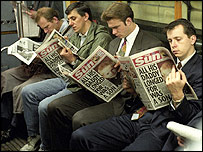 Newspaper readers on the Tube