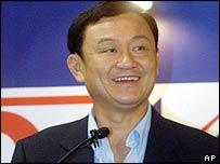 Thai Prime Minister Thaksin Shinawatra smiles during a press conference in Bangkok