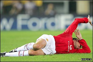 United's Argentina international defender Gabriel Heinze rolls in agony as his game comes to a premature end
