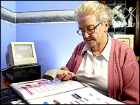 Lady using scanner - Somerfield