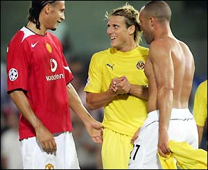 Man Utd's Rio Ferdinand and Mikael Silvestre exchange pleasantries with Diego Forlan at the final whistle