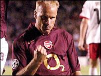 Dennis Bergkamp celebrates scoring against FC Thun
