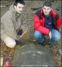 Tomasz Sierkierski (right) inspects graves