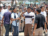 Members of the Free Aceh Movement hand over their weapons. File photo