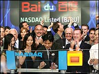 Baidu staff and Nasdaq officials celebrate the company's stock market debut