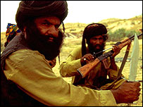 A Baloch tribesman holds up a weapon of choice