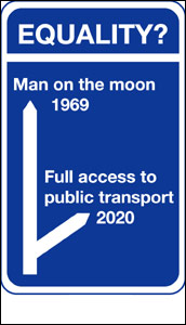 Image of a blue motorway type sign which reminds people that a man was sent to the moon in 1969 but that transport in the UK will not be accessible until 2020