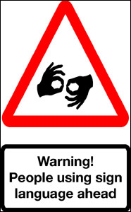 Image of a red triangular warning sign inside which two hands have thumb and forefinger forming a circle - a popular gesture of abuse on the roads