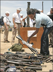 A member of the Free Aceh Movement surrenders his weapons to the Aceh Monitoring Mission in Banda Aceh, Thursday, Sept 15, 2005.