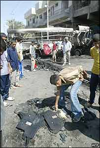 Iraqis gather at the site of a suicide attack in Baghdad on 15 September 2005