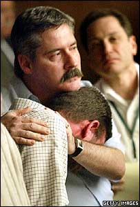 John Harris, who says he too was abused by Shanley, is comforted in court by Robert Costello, the alleged victim of another priest