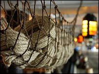 A rope hammock on board HMS Victory