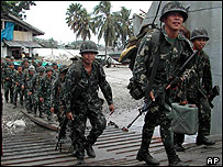 Philippine Marines board a navy transport ship for the island of Jolo Tuesday, Feb 8, 2005