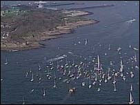 The flotilla of ships surrounding Ellen MacArthur's trimaran