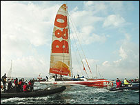Ellen MacArthur's boat is accompanied back into Falmouth by a flotilla of boats