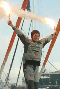 Ellen MacArthur celebrates on board her boat