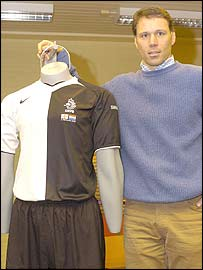 Holland coach Marco van Basten displays the new kit