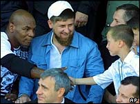 Mike Tyson shakes hands with boy as Ramzan Kadyrov watches