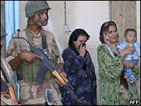 Iraqi women cry as Iraqi soldiers arrest family members in Tal Afar, northern Iraq