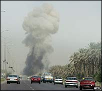 Smoke rises in the air at the site of a suicide attack in Baghdad