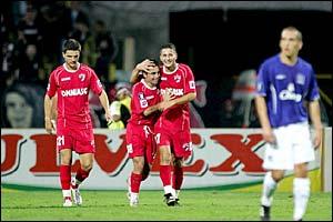Alexandru Baltoi of Dinamo congratulates Florentin Petre on scoring the third goal for Bucuresti