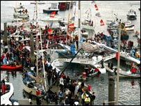 Ellen MacArthur's boat surrounding by crowds in Falmouth