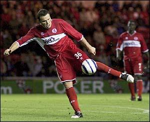 Striker Mark Viduka scores for Middlesbrough