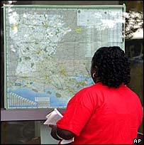 A New Orleans woman studies a map of the state of Louisiana at a Red Cross shelter in Baton Rouge