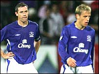 Everton captain David Weir and Phil Neville after another goal goes in