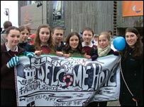 Children holding a banner