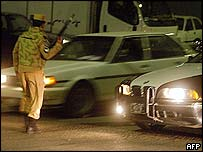 Kuwait security forces checking traffic