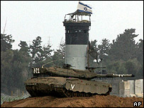 Israeli tank guards Jewish settlement of  Kfar Darom in the Gaza Strip