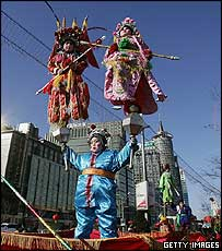 Chinese children dressed in traditional costumes perform outside a temple on New Year's Day February 9, 2005 in Beijing