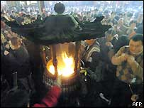 Local residents burn incenses and pray for luck at Hsing Tien Temple in Taipei, 9 feb