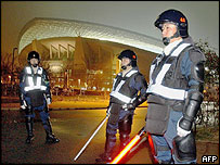 Japanese riot police stand guard in front of Saitama Stadium, north of Tokyo, 08 February