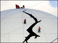 Greenpeace activists on the reactor dome of the Dutch power plant in Borssele, Getty Images 