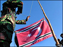 Gam rebels hoist up their flag, archive picture