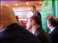 Three of Plaid Cymru's MPs listen to their colleague Adam Price