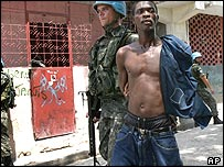 UN peacekeepers detain a suspected gang member in the capital, Port-au-Prince