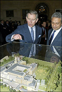 Prince Charles views a model of The Oxford Centre for Islamic Studies in Oxford