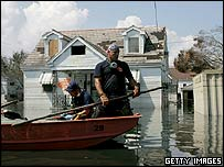 Rescuers continue to patrol flooded New Orleans, 16 September 2005
