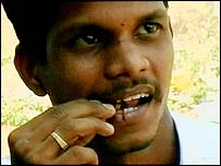Ramesh Kumar eating a cockroach