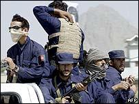 Afghan policemen patrol in Kandahar
