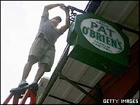 Fixing a sign at the Pat O'Brien's French Quarter bar