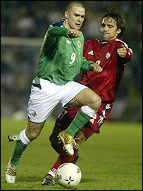 David Healy of Northern Ireland is chased by Canada's Daniel Imhof