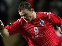 Wayne Rooney wearing England's No To Racism shirt