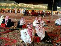 Supporters of a municipal election candidate gather outside his campaign tent in Riyadh