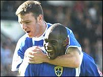 Cardiff striker Michael Ricketts celebrates his winner with Jason Koumas