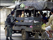 Armed policeman manning a road block in Jolo island, 10 February