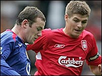 Man Utd's Wayne Rooney and Liverpool's Steven Gerrard in action at Anfield